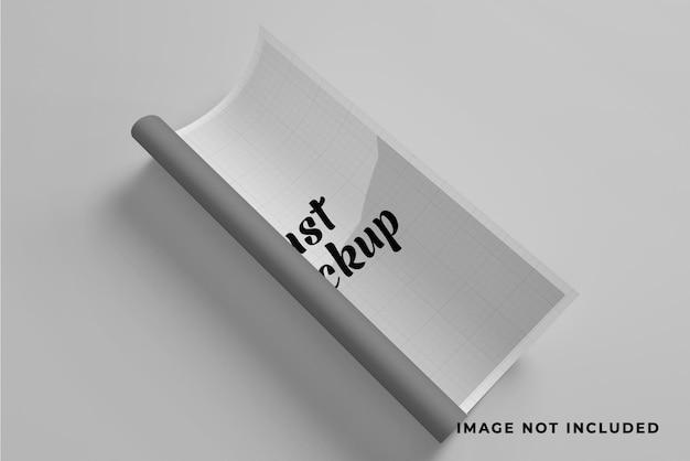W połowie zwinięta makieta lub plakat w formacie a4