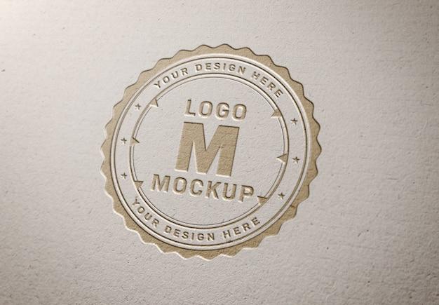 Wciśnięty logo makieta na białej księdze tekstury