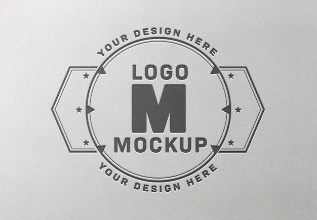 Wciśnięty logo makieta na tekstury białego papieru