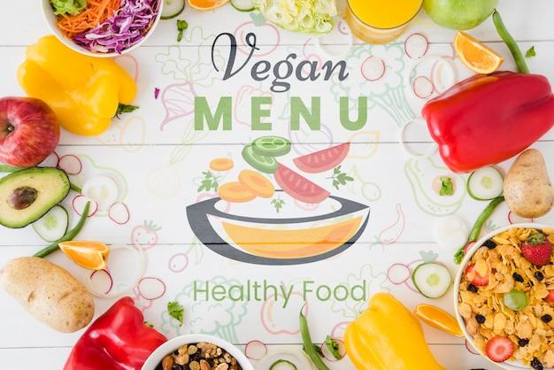 Wegańskie tło menu z warzywami koło