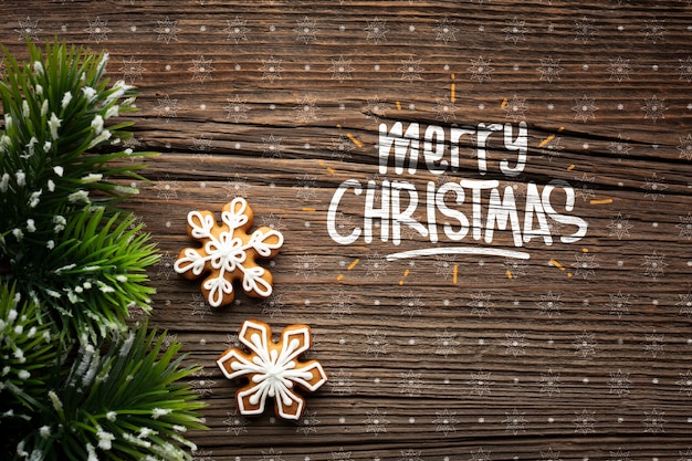 Wesołych świąt z gwiazdami i świątecznymi liśćmi sosny