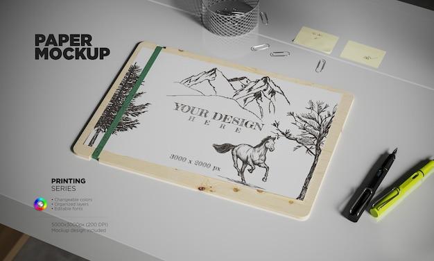Widok izometryczny szablon papieru a4 z piórami wiecznymi na biurku