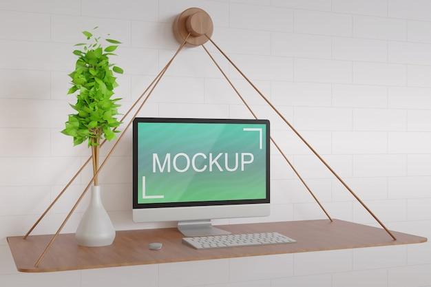 Widok z boku makieta ekranu komputera na drewnianym wiszącym stole