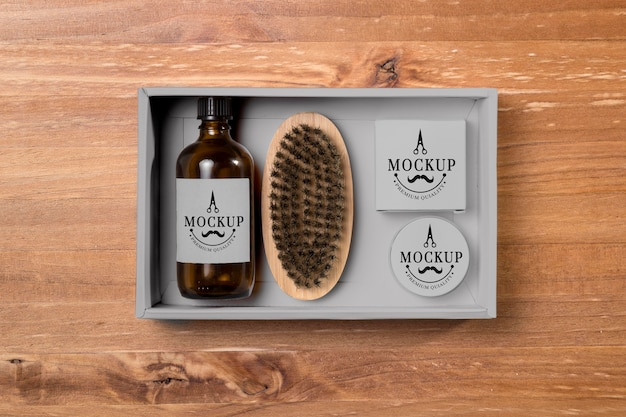 Widok z góry na produkty do pielęgnacji brody z balsamem i szczoteczką