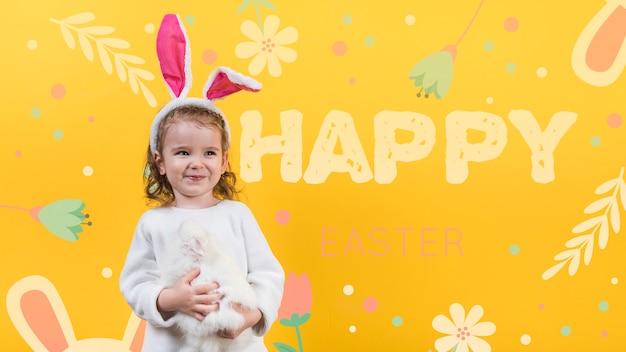 Wielkanocna makieta z dziewczyną i królikiem