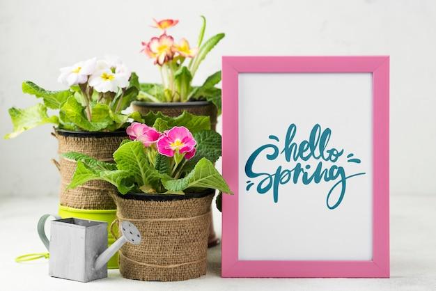 Witaj makieta wiosny z kwiatami