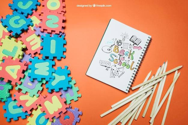 Wróć do szkoły szablonu z układanki i notebooka