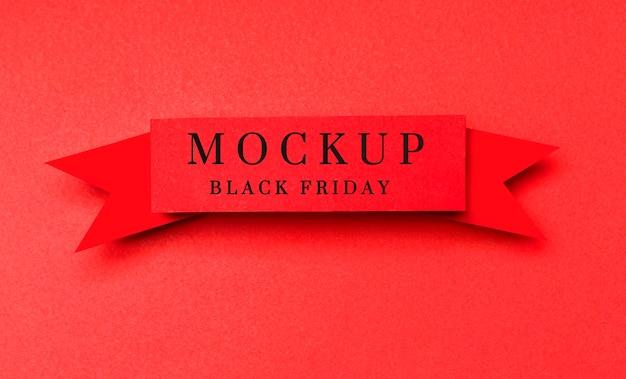 Wstążka na czerwonym tle makieta sprzedaży w czarny piątek