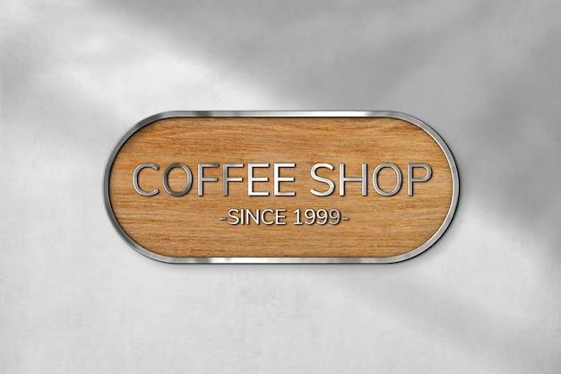 Wytłaczana makieta logo psd w drewnianej fakturze