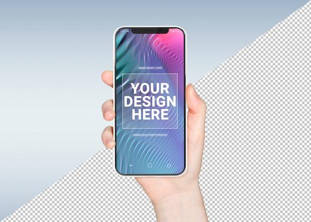 Wytnij rękę kobiety trzymającej biały smartfon makieta
