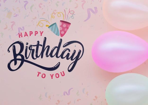 Zadowolony urodziny napis z pastelowymi balonami