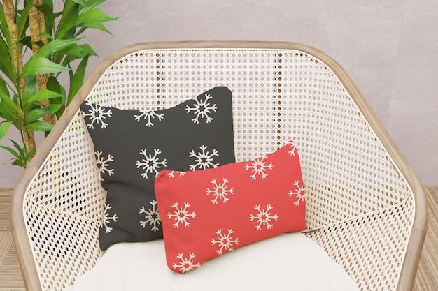 Zamknij się na makiecie poduszki na wiklinowym krześle