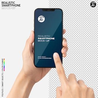 Zbliżenie dłoni trzymającej i używającej makiety smartfona