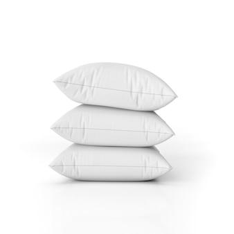 Zestaw pustych poduszek na białym tle