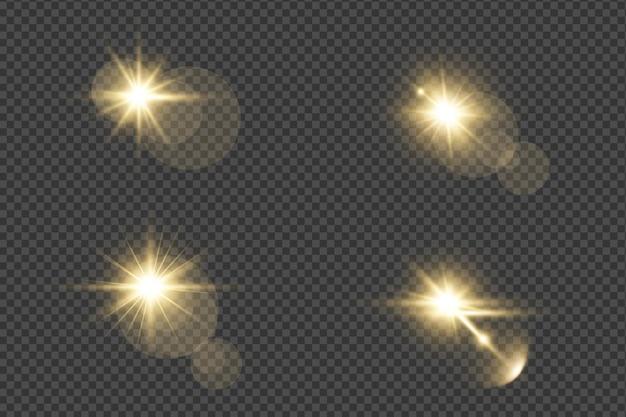 Zestaw realistycznych złotych rozbłysków soczewkowych