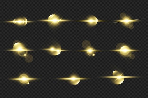 Zestaw realistycznych złotych świecących flar