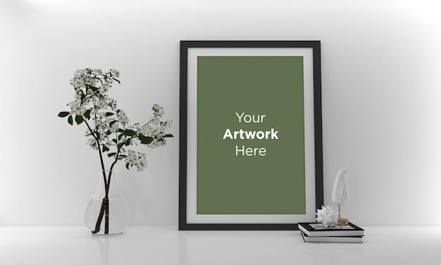 Zielona roślina i pusta ramka na zdjęcia