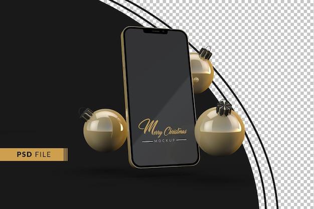 Złote boże narodzenie ze złotą makietą iphone'a 13 i złotymi bożonarodzeniowymi kulami