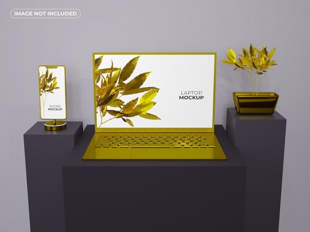 Złoty smartfon i makieta laptopa
