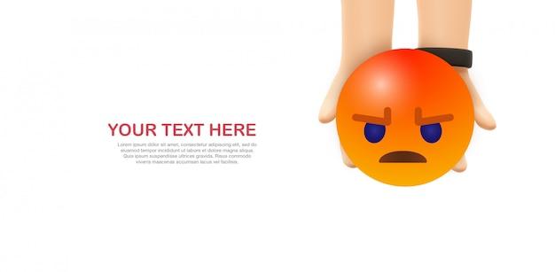 Zły emoji - ręce trzymają żółty emotikon na facebooku