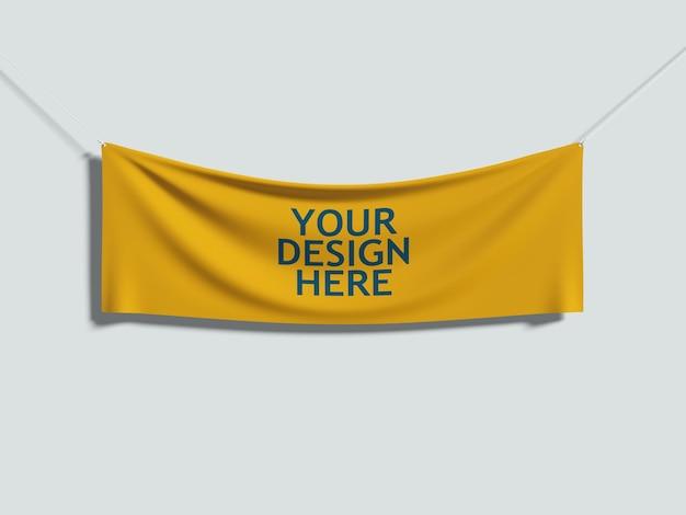Żółty materiał zawieszony na sznurkach