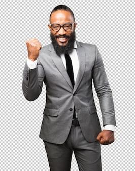 Zwycięzca czarny człowiek biznesu