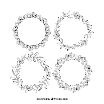 Ładny zestaw ręcznie rysowane klatek kwiatowy