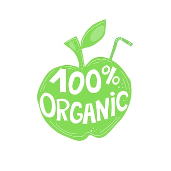100 organicznej karykatury ręcznie rysujący napis na zielonym jabłku