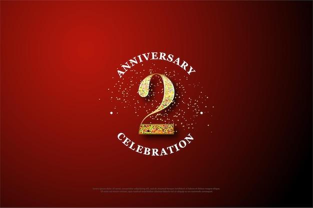 2 rocznica tło z złotym brokatem rozrzuconym wokół cyfr.