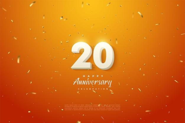 20. aniversary tło z białymi cyframi na pomarańczowym tle i posypką złotym papierem
