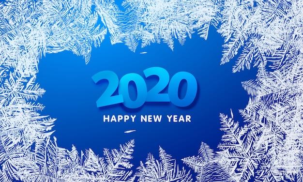 2020 szczęśliwego nowego roku z niebieską zimową dekoracją i płatkami śniegu