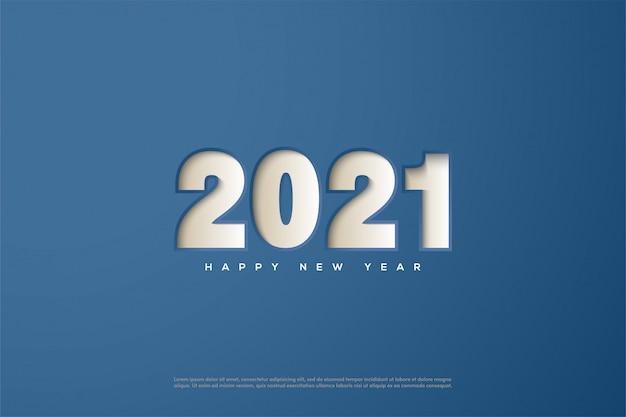 2021 szczęśliwego nowego roku z cyframi wytłoczonymi na niebieskim papierze