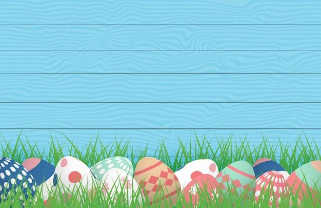 3d wesołych świąt z kolorowymi jajkami na polu trawy z drewnianymi
