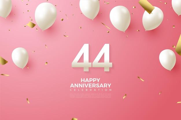44 rocznica z białymi cyframi i balonami