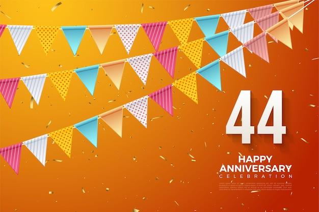 44 rocznica z kolorowymi cyframi i flagami