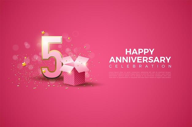 5. rocznica ze złotymi numerami na krawędzi i pudełkiem upominkowym.