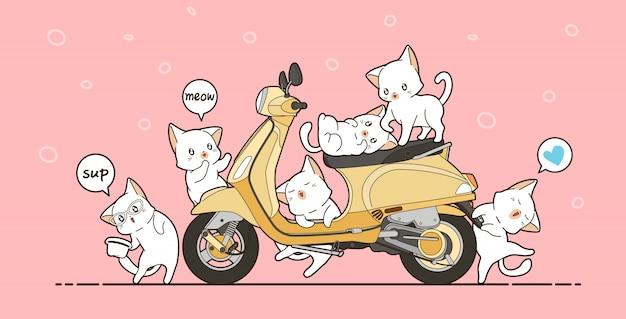 6 uroczych kotów i żółty motocykl w stylu kreskówki.