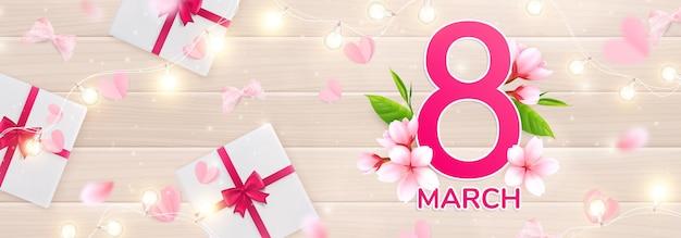 8 marca womans day ilustracja ze światłami, różowymi płatkami i ilustracją pudełek na prezenty