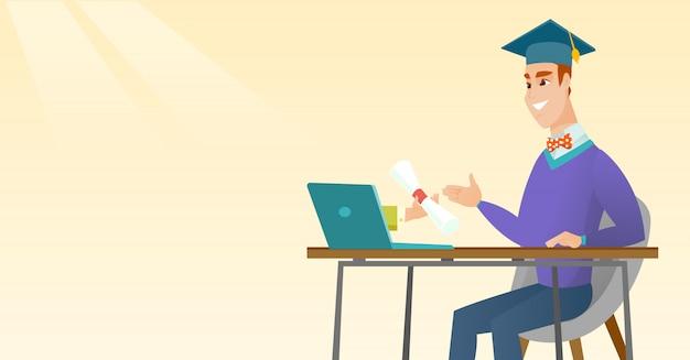 Absolwent uzyskujący dyplom z komputera.