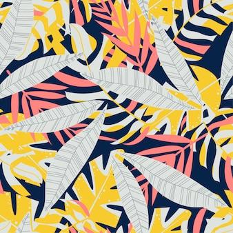 Abstrakcjonistycznego trendu bezszwowy wzór z kolorowymi tropikalnymi liśćmi i roślinami
