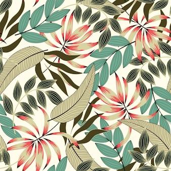 Abstrakcjonistyczny bezszwowy tropikalny wzór z jaskrawymi zielonymi roślinami i liśćmi