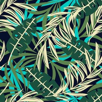 Abstrakcjonistyczny bezszwowy wzór z jaskrawymi tropikalnymi liśćmi i roślinami