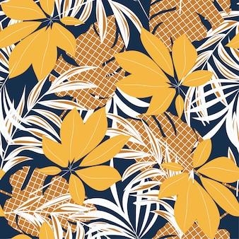 Abstrakcjonistyczny bezszwowy wzór z kolorowymi tropikalnymi liśćmi i roślinami na błękitnym tle