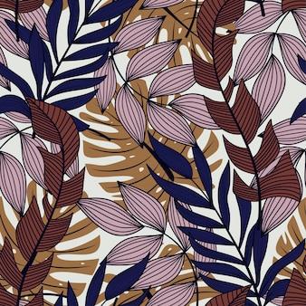 Abstrakcjonistyczny bezszwowy wzór z kolorowymi tropikalnymi liśćmi i roślinami na pastelowym tle