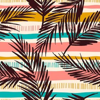 Abstrakcjonistyczny bezszwowy wzór z tropikalnymi liśćmi.
