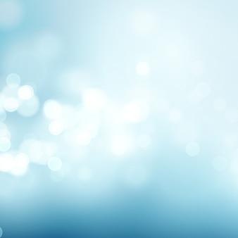 Abstrakcjonistyczny błękitny kółkowy bokeh tło