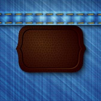 Abstrakcjonistyczny drelichowy tło z rzemienną etykietką