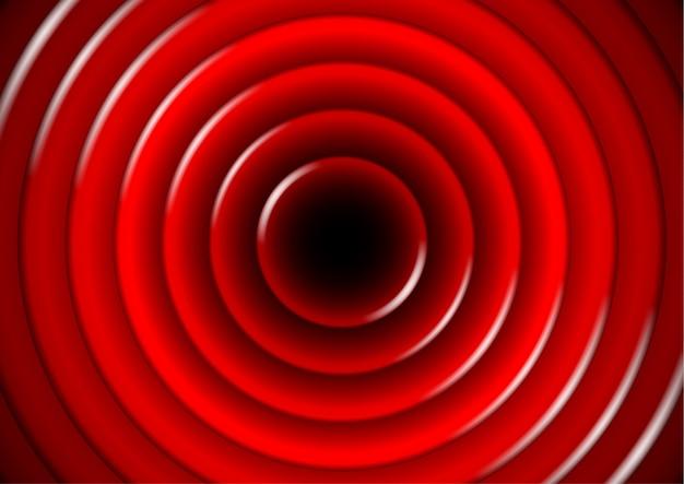 Abstrakcjonistyczny tło z glansowanymi czerwonymi okręgami