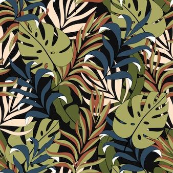 Abstrakcjonistyczny tropikalny bezszwowy wzór z pięknymi żółtymi i błękitnymi liśćmi i roślinami