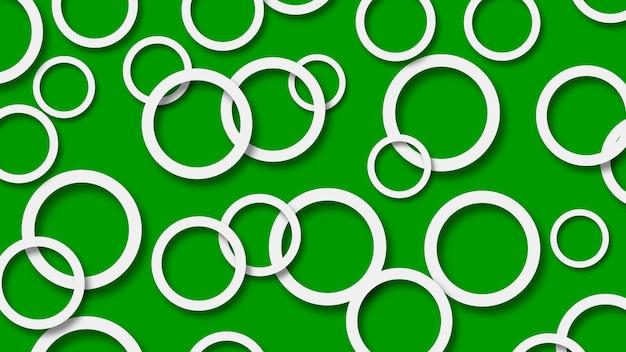 Abstrakcyjna ilustracja losowo ułożonych białych pierścieni z miękkimi cieniami na zielonym tle